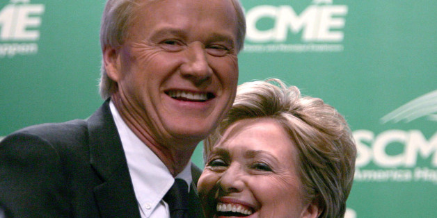 Panel moderator Chris Matthews of MSNBC, left, hugs Senator